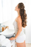 Young woman standing in bathroom Royalty Free Stock Photo
