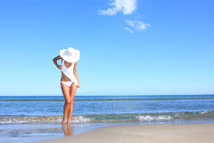 Young woman standing on a beach Stock Images