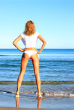 Young woman standing on a beach Royalty Free Stock Photos