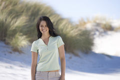 A young woman standing on a beach Stock Photos