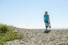 Young Woman Standing On Beach Royalty Free Stock Images