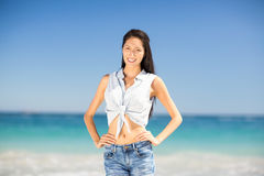 Young woman standing on beach Stock Images
