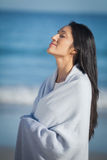 Young woman standing on beach Stock Photo