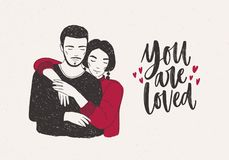 Young woman standing behind man and warmly embracing him and You Are Loved hand lettering decorated with tiny hearts. Loving romantic couple. Vector Royalty Free Stock Photography