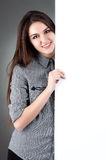 Young woman standing with billboard isolated. On white background Royalty Free Stock Photography
