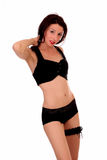 Young woman standing in black lingerie garter Stock Photos