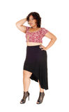 Young woman standing in black skirt. Stock Photo