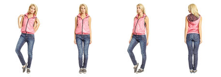 Young woman standing in blue jeans on white background Royalty Free Stock Image