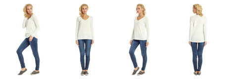 Young woman standing in blue jeans on white background Royalty Free Stock Photo