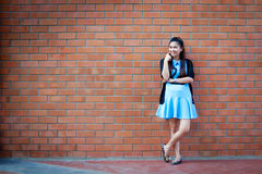 Young woman standing with brick wall Royalty Free Stock Photography