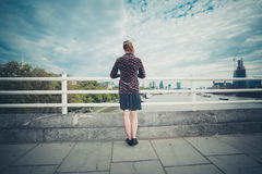 Young woman standing on bridge in city Royalty Free Stock Photos