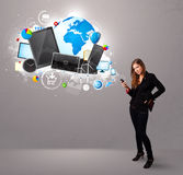 Young woman standing and browsing on her phone Stock Photography