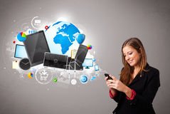 Young woman standing and browsing on her phone Stock Photos