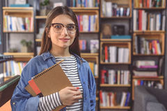 Young woman standing in campus library Royalty Free Stock Photos