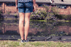 Young woman standing by canal Stock Photos