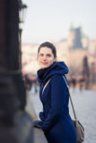 Young woman standing on the Charles Bridge in Prague Stock Photo