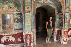 Young woman standing in Chitrashala hall, Bundi Palace, India Stock Photo