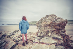 Young woman standing on the coast Royalty Free Stock Image