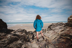 Young woman standing on the coast Stock Images