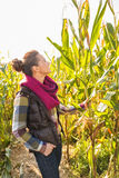 Young woman standing in cornfield Stock Image