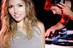 Young woman standing by the DJ royalty free stock photos