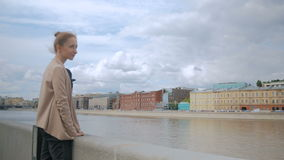 Young woman looking at historical part of city stock video