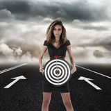 Young woman standing on empty road Stock Photography