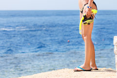 Young woman standing with equipment for snorkeling Royalty Free Stock Photography