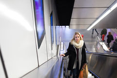 Young woman standing at the escalator in Vienna subway Royalty Free Stock Images