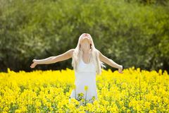 Young Woman Standing In Field Royalty Free Stock Photos