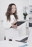 Young woman standing with folder with paperwork Royalty Free Stock Photos