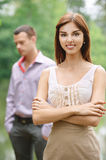 Young woman standing in front Stock Photography
