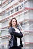 Young woman standing in front of construction site Stock Image