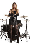 Young woman standing in front of drumkit Royalty Free Stock Photography