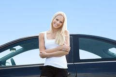 Young Woman Standing In Front Of Her Car Royalty Free Stock Photo