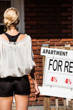Young Woman standing in front of her new apartment Stock Image