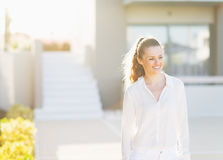 Young woman standing in front of house building Royalty Free Stock Images