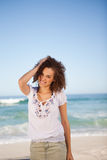 Young woman standing in front of the sea Stock Photography