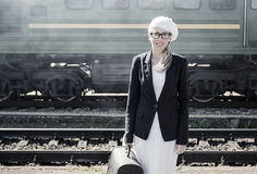 Young woman standing in front of train Royalty Free Stock Photography