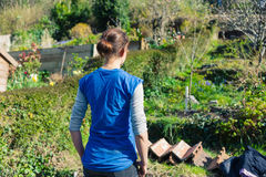 Young woman standing in garden Royalty Free Stock Photo