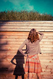 Young woman standing in garden outside cabin Royalty Free Stock Images