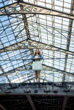 Young woman standing on glazed balcony at airport terminal Royalty Free Stock Images