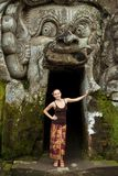 Young woman standing at Goa Gajah Royalty Free Stock Photos