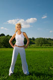 Young woman standing on a green grass Royalty Free Stock Photography