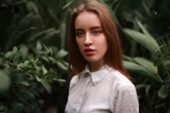 Young woman standing at a greenhouse Royalty Free Stock Photo