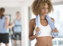 A young woman standing in a gym Royalty Free Stock Photos