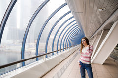 Young woman standing in the hall Stock Photo