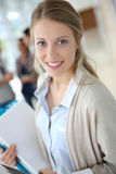Young woman standing in hallway Royalty Free Stock Photo