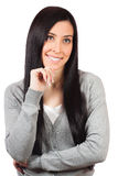 Young woman standing with hands folded Royalty Free Stock Photography