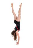 Young woman standing on hands during a gymnastics exercise. isolated over white Stock Photo